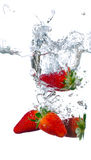 Splashing strawberry Royalty Free Stock Image