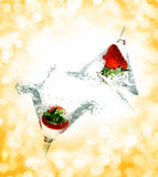 Splashing strawberry Stock Images