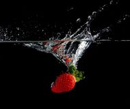 Splashing Strawberry Stock Photography