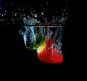 Splashing Strawberry royalty free stock photo