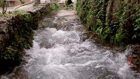 Splashing stream water in slow motion stock video footage