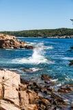 Splashing Surf Among Rocks Stock Photography