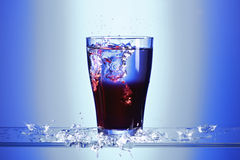 Splashing syrup drink Stock Photo