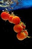Splashing tomato Royalty Free Stock Photo