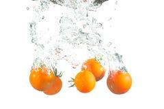 Splashing tomatoes Royalty Free Stock Photo