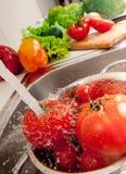 Splashing vegatables Stock Photo