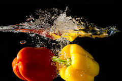 Splashing Vegetables on water Royalty Free Stock Photos