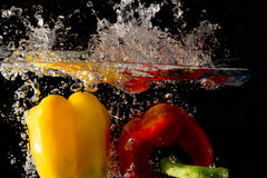 Splashing Vegetables on water Stock Images