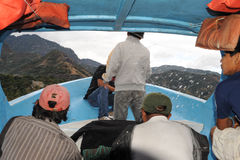 Splashing water on a boat in lake Atitlan Royalty Free Stock Images
