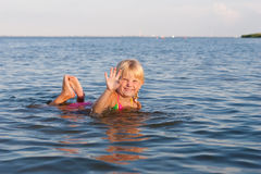 Splashing in the water child Stock Photography