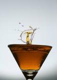 Splashing water drop on glass. Splashing water drop on red glass Stock Image
