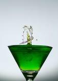 Splashing water drop on glass Stock Images