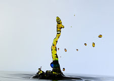 Splashing water drops and shaped a snake. Color waterdrops collide each other against gray background and shaped a snake Royalty Free Stock Photography