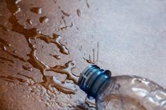 Splashing water on the floor. Of a dropped plastic bottle stock photos