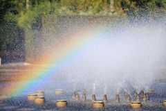 Splashing water of a fountain with rainbow Royalty Free Stock Photo