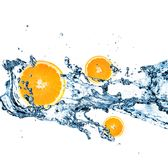 Splashing water with oranges Royalty Free Stock Photos