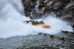 Splashing Water Ride at Theme Park Stock Images