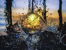 Splashing water at sunset