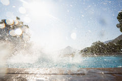 Splashing water in swimming pool Stock Image