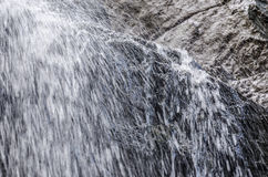 Splashing waterfall in ravine Stock Photos