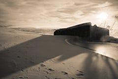 Huge powerful splashing wave of atlantic ocean against blockhouse silhouette in sunset sky in black and white sepia, capbreton, Stock Images