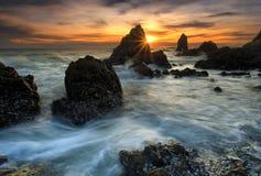 Splashing wave with beautiful sunset Royalty Free Stock Image