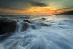Splashing wave with beautiful sunset. Thailand Stock Images