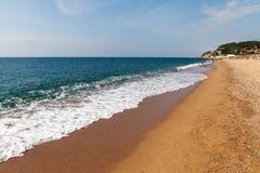 Splashing wave on Calella beach, Spain. Stock Photos