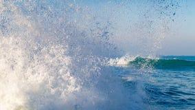 Splashing wave near the coast stock images