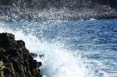 Splashing Waves. Waves of water splashing on the seaside rocks royalty free stock images