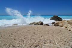 Splashing waves on empty beach Royalty Free Stock Photography