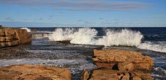 Splashing waves at Maroubra Beach, Sydney Royalty Free Stock Images
