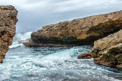 Splashing waves at a rough and rocky coastline Stock Image