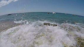 Splashing waves. Slow motion shot of splashing sea wave on stone Adriatic beach stock video footage