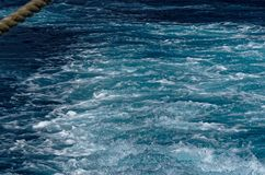 Ship wake in turquoise sea water. This photo was taken from a ferry in Malta stock images