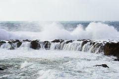 Splashing Waves. Water washed rock in the ocean Royalty Free Stock Photo