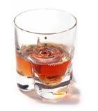 Splashing whiskey Royalty Free Stock Photos