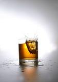 Splashing whiskey Stock Photography