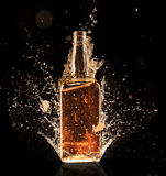 Splashing whiskey Stock Images