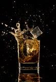 Splashing whiskey Royalty Free Stock Images