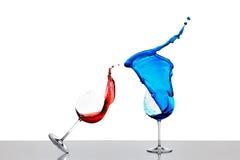 Splashing wine glasses Stock Photo