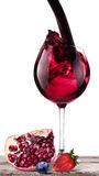 Splashing wine with pomegranate, blueberrie, strawberry Royalty Free Stock Photos
