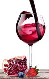 Splashing wine with pomegranate, blueberrie, strawberry Royalty Free Stock Photo