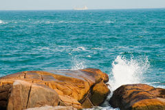Splashy water waves. Sea waves splashes on big rocks at Shek-O beach in Hong kong Stock Photos