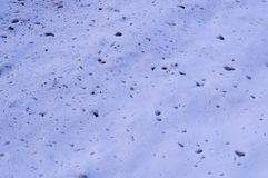 Splats of dirt on the snow near the road texture. background, seasonal. Splats of dirt on the white snow near the road texture. background, seasonal stock images