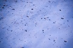 Splats of dirt on the snow near the road texture with vignette. background, seasonal. Splats of dirt on the white snow near the road texture with vignette stock images