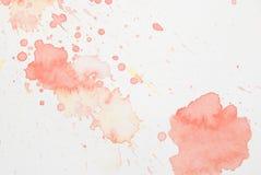 Splatter rosso e giallo luminoso dell'acquerello Immagine Stock Libera da Diritti