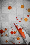 Splattered blood stain with knife Royalty Free Stock Photo