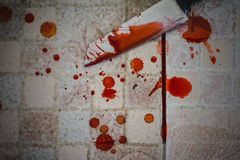 Splattered blood stain with knife Stock Images
