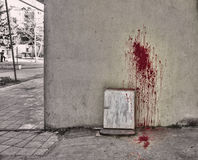 Splattered blood stain on white background. Halloween background. Blood on wall and ground. Outdoor Royalty Free Stock Photography